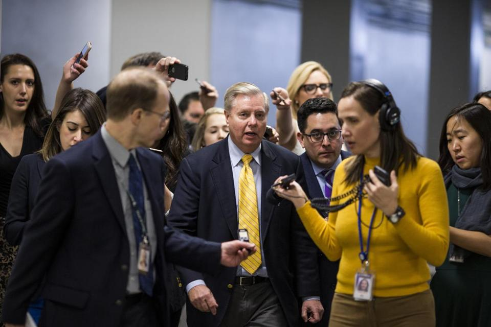 Senator Lindsey Graham (center)